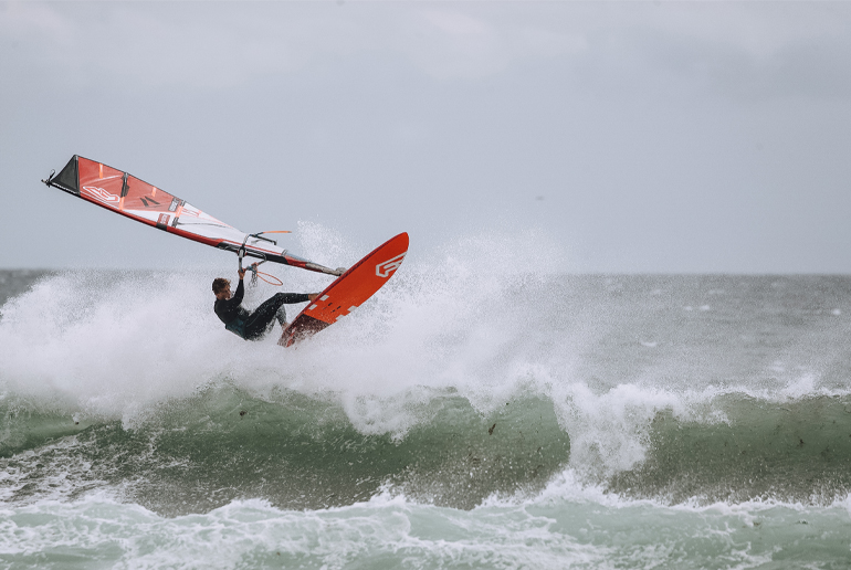 CHIEMSEE Family Member Marco Lufen riding a wave